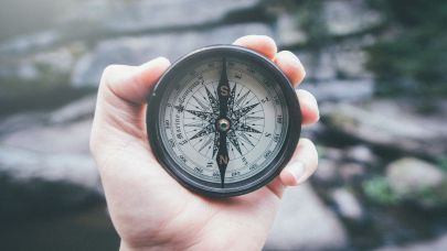 close-up-of-hand-holding-navigational-compass-royalty-free-image-903093770-1567192211.